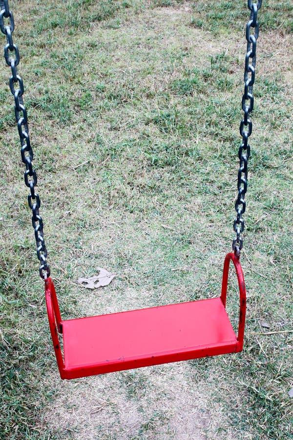 röd swing royaltyfria bilder