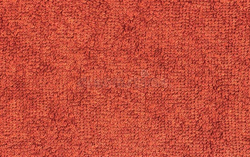 Röd Terrycloth, bakgrund för closeuptygtextur arkivfoto
