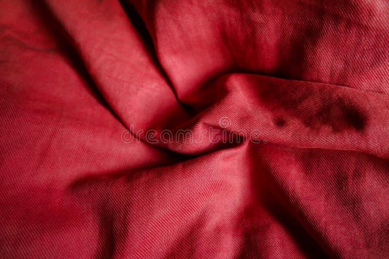 Röd textilbakgrund med textur royaltyfri foto