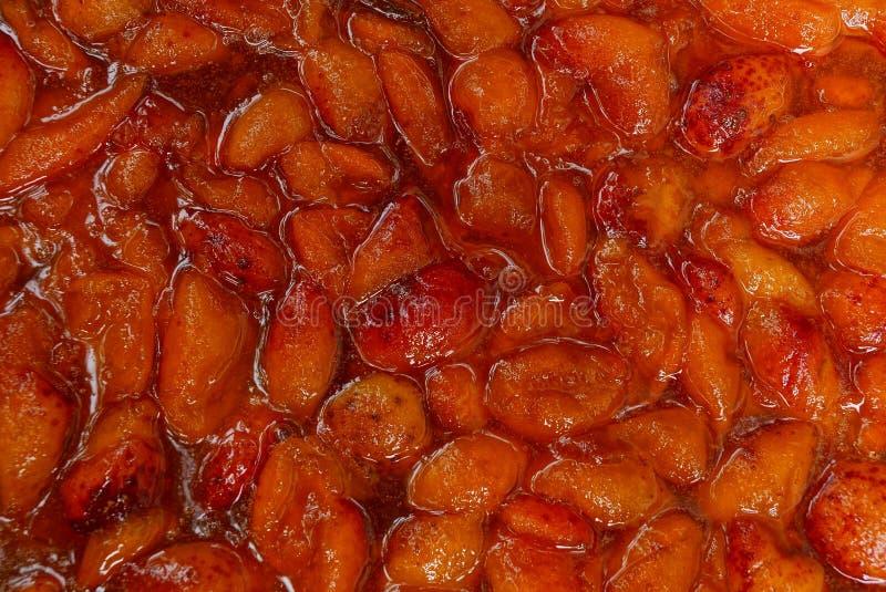Röd textur av driftstopp från aprikosbär royaltyfria foton