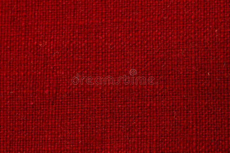 Röd tygtextur royaltyfria bilder