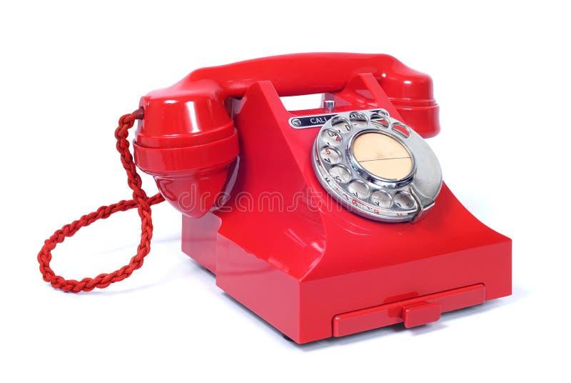 Röd visartavlatelefon för tappning royaltyfria bilder