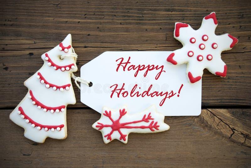 Röd vit vinterbakgrund med lyckliga feriehälsningar arkivbild