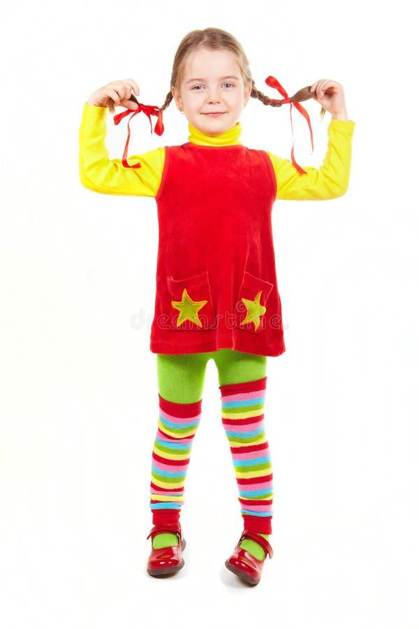 röd yellow för klädd flicka royaltyfri bild