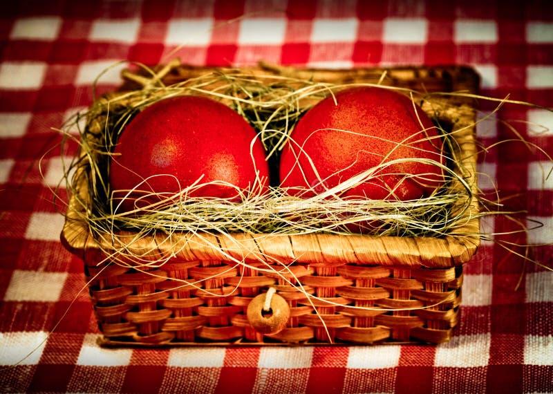 Röda ägg för påsk i retro stil royaltyfria bilder