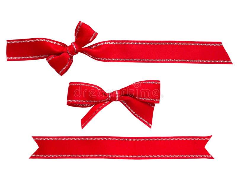Röda band och pilbågar arkivfoton