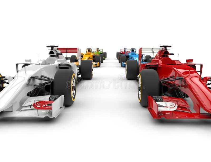 Röda bilar för formel en - och vit framtill rad royaltyfri fotografi