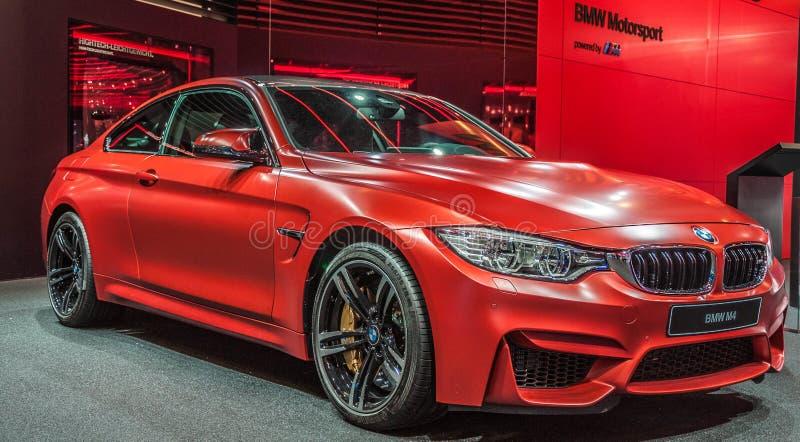 Röda BMW M4 royaltyfria bilder