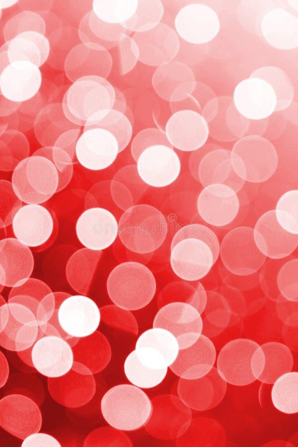 Röda defocused ljus som är användbara som en bakgrund Goda för websitedesigner eller textur arkivfoto