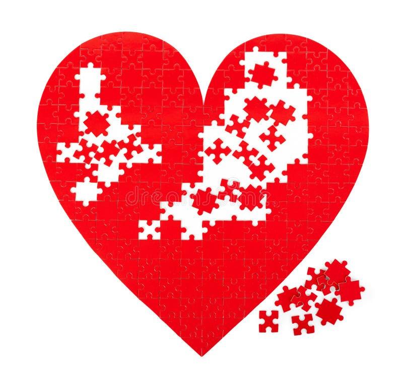 Röda hjärtapussel royaltyfri bild