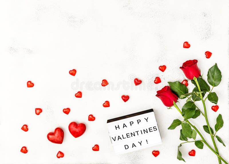 Röda hjärtor steg asken för dagen för blommagarneringvalentin den ljusa arkivbild