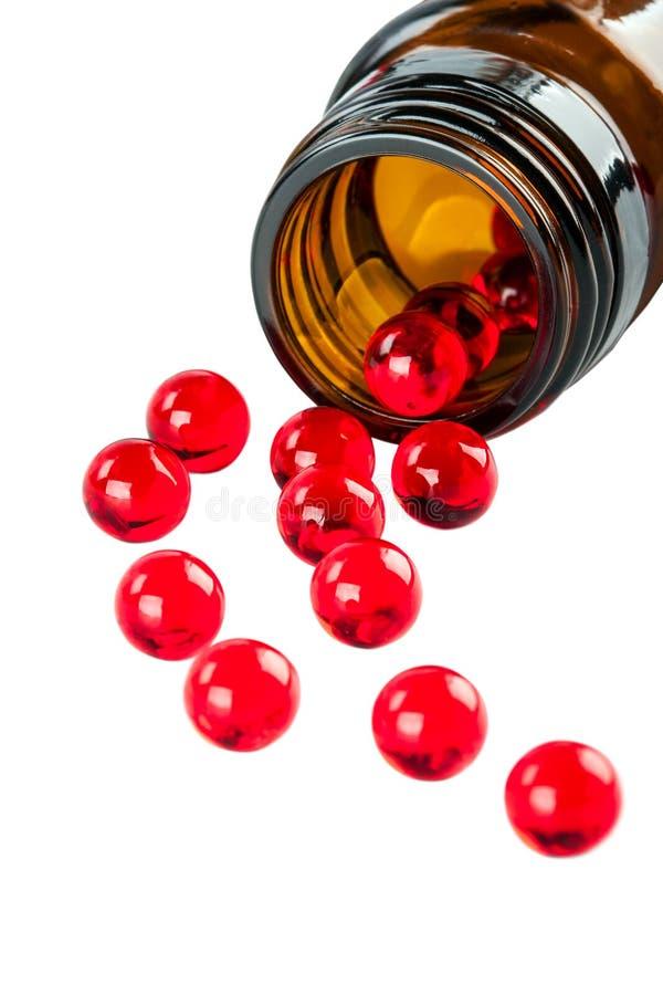 Röda kapslar arkivfoton