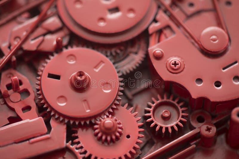 Röda kugghjul och kuggar fotografering för bildbyråer