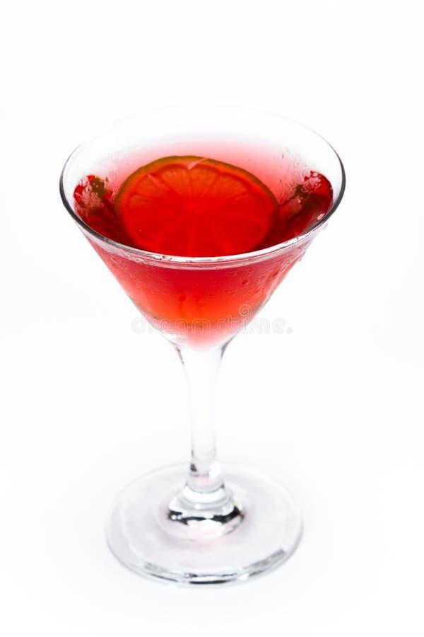 Röda martini över vit arkivfoto