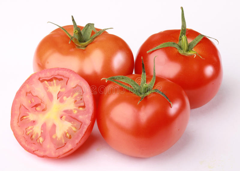 röda mogna tomater arkivfoto