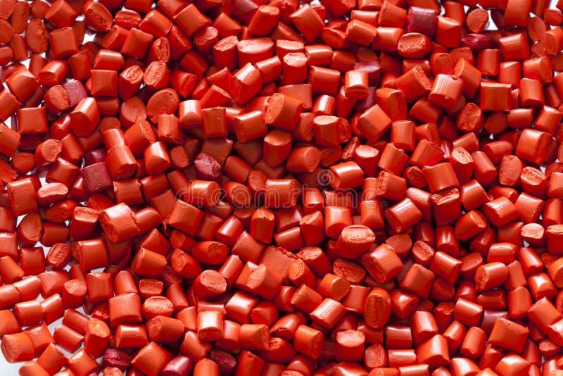 Röda plast- partiklar royaltyfria foton