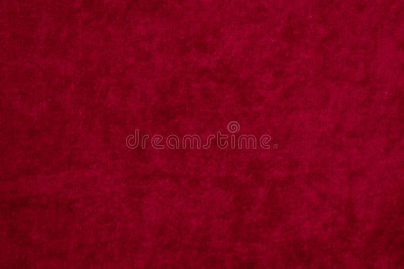 röda serier texture sammet arkivfoto