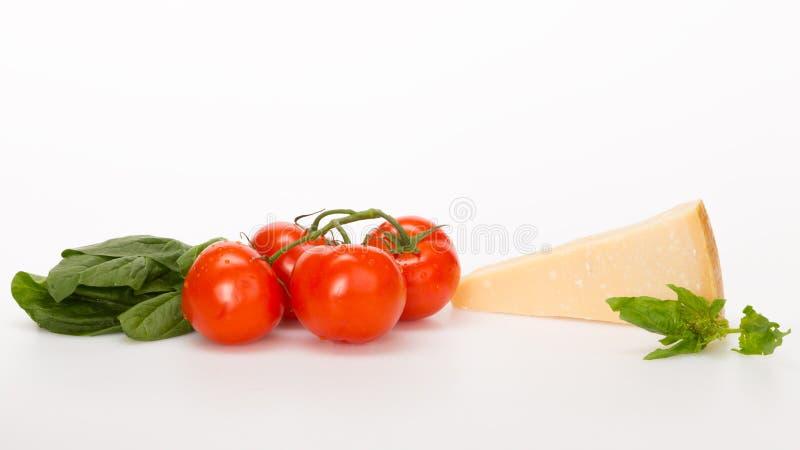 Röda tomatostspenat arkivfoto