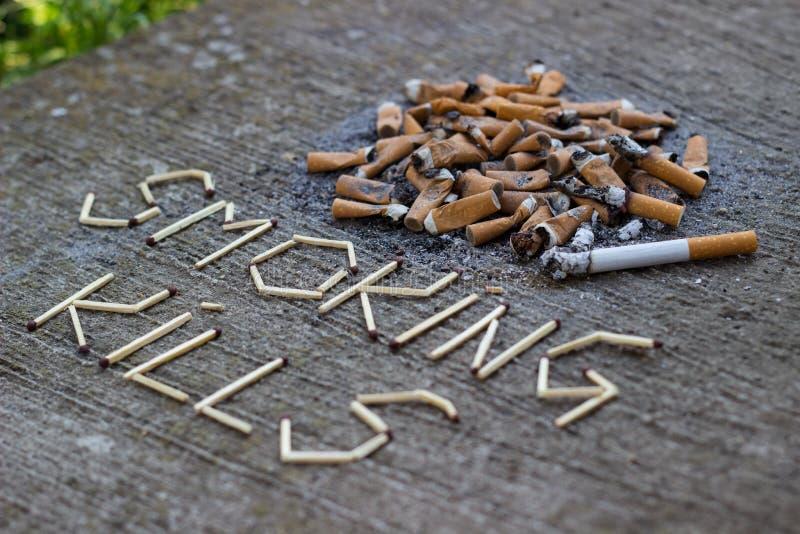 Röka byten arkivfoton