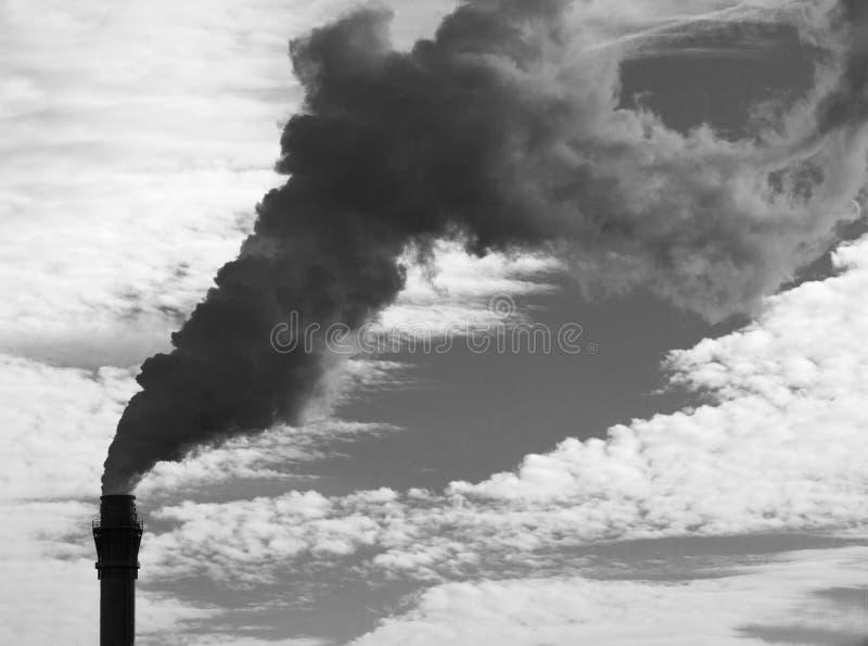 Röka lampglaset producera växthusgaser royaltyfria foton