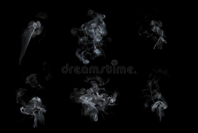 Röksamling som isoleras på svart bakgrund royaltyfri foto
