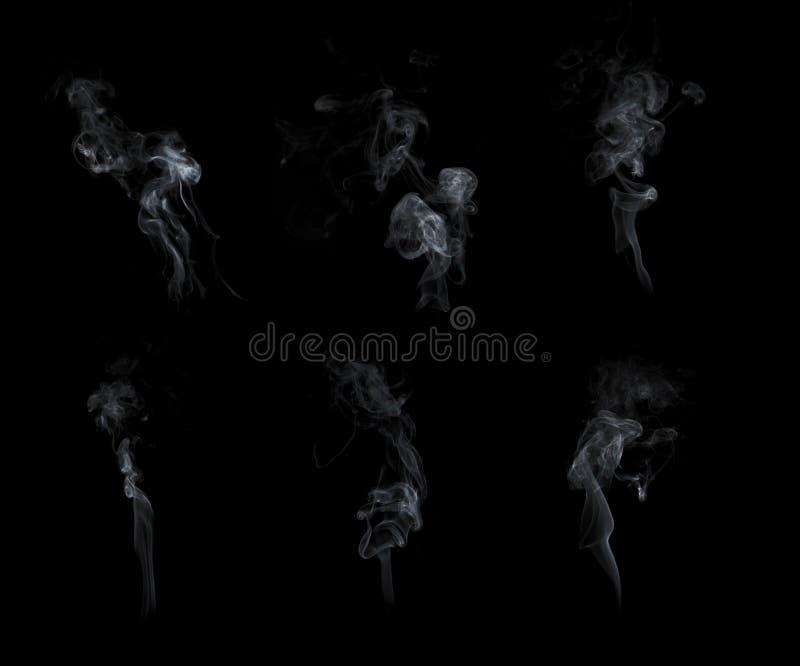 Röksamling som isoleras på svart bakgrund royaltyfri bild