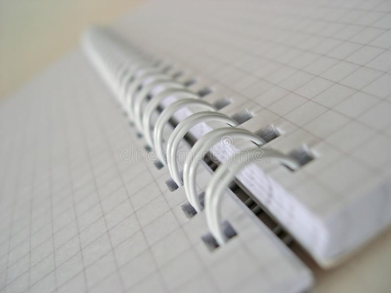 Röra sig i spiral - den destinerade anteckningsboken arkivfoto