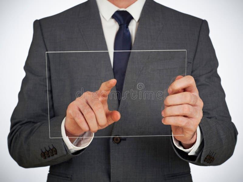 Rörande glass skärm för affärsman royaltyfri foto