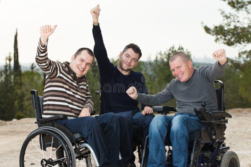 Rörelsehindrade vänner arkivbild