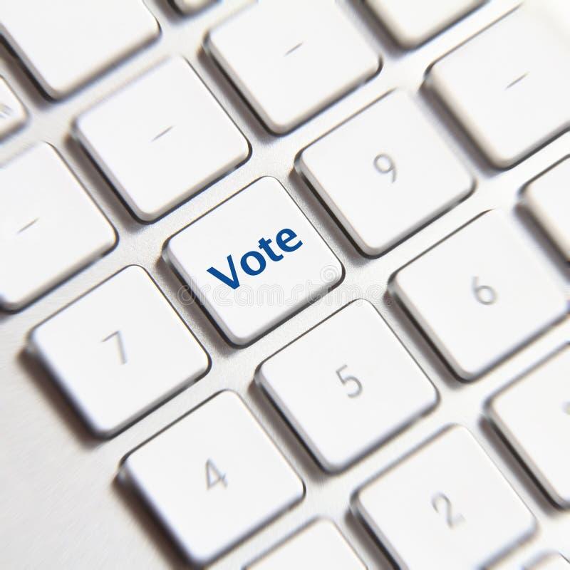 Rösta knappen arkivfoto