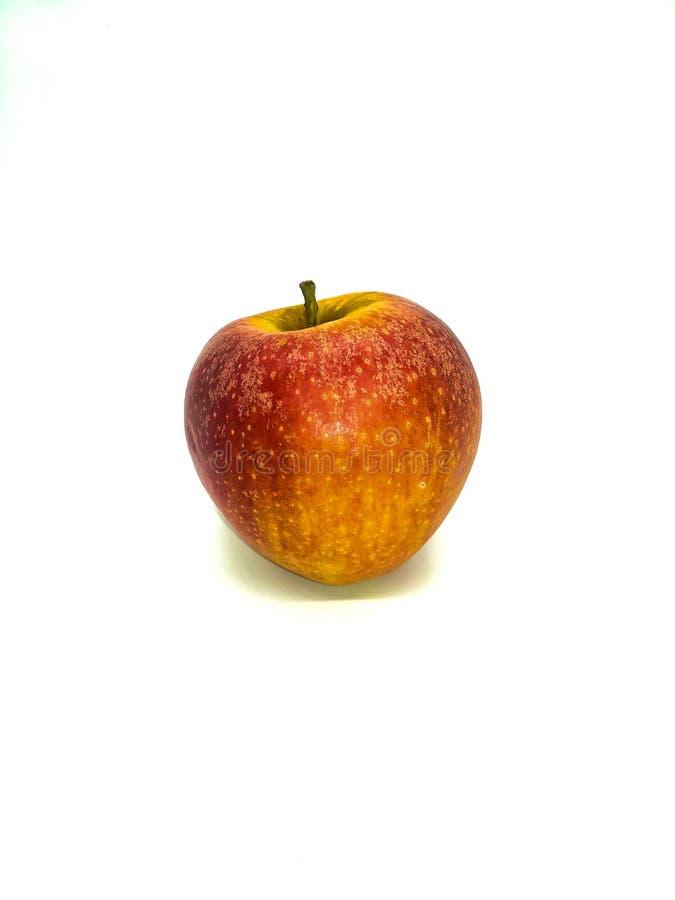 Rött äpple med gula fläckar arkivbild