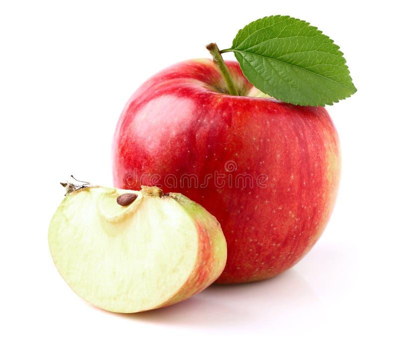 Rött äpple med skivan arkivfoton