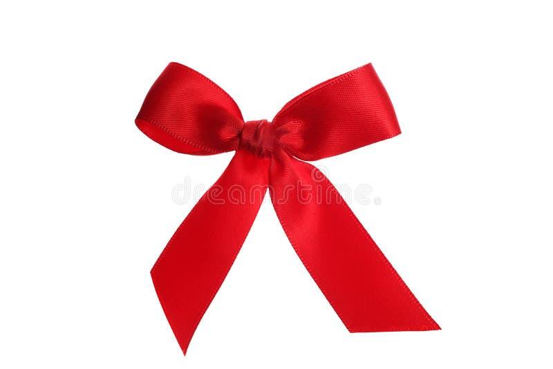 Rött band för dekorativ jul som isoleras på vit bakgrund med den snabba banan royaltyfria bilder