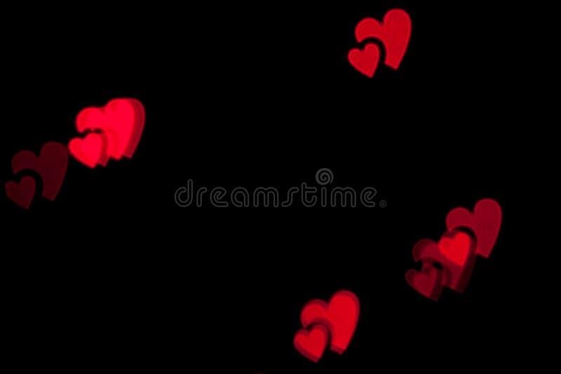 Rött foto för bakgrund för hjärtabokehsvart royaltyfri fotografi
