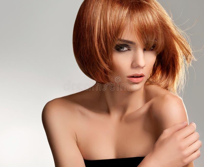 Rött hår. Högkvalitativt avbilda. arkivbild