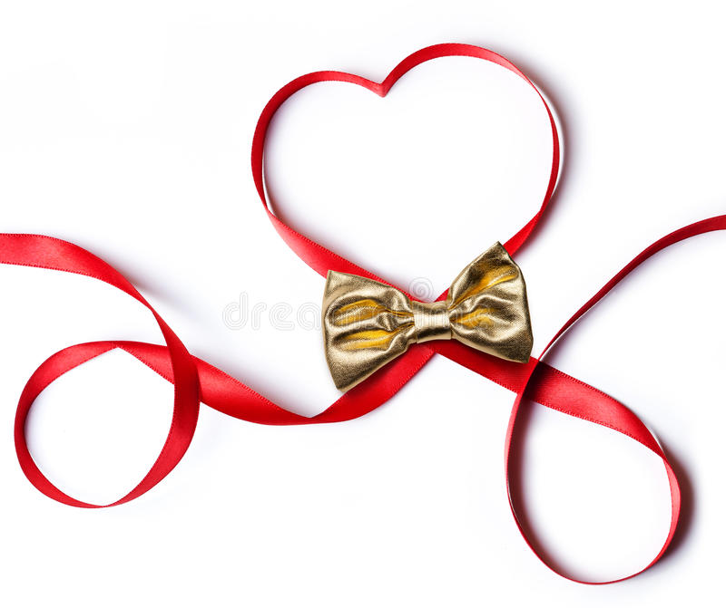 Rött hjärtaband med den guld- pilbågen royaltyfria bilder