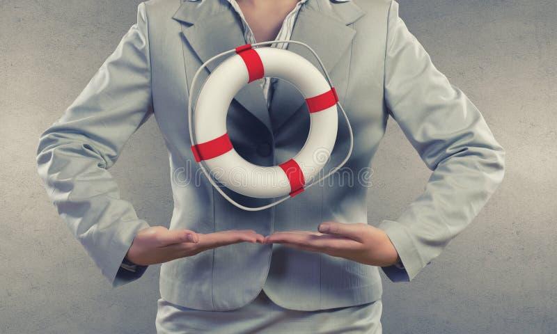 Rött lifebuoy med humanen som isoleras på vit bakgrund royaltyfria foton