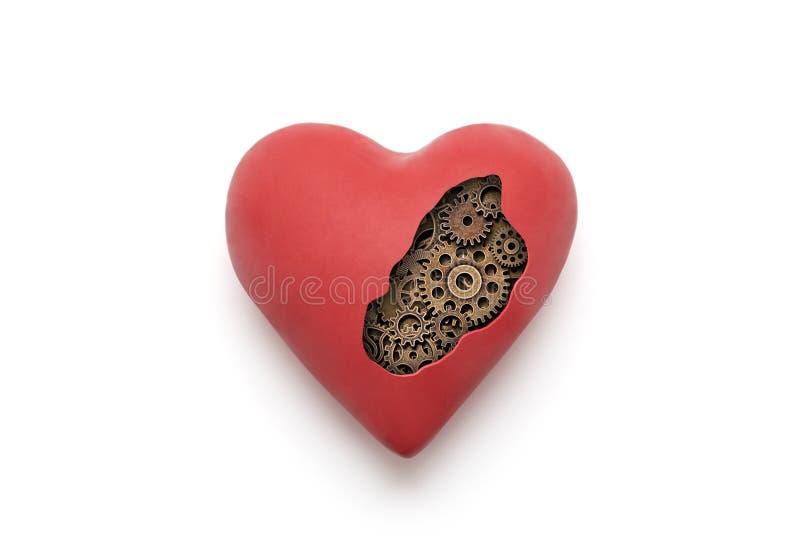 Rött mekaniskt hjärta över vit bakgrund royaltyfri bild