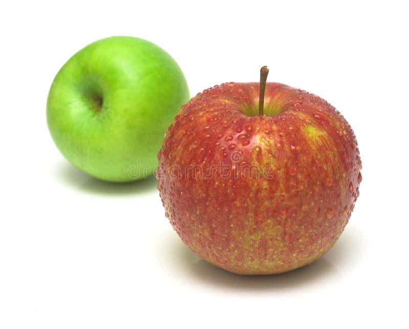 Rött och grönt äpple royaltyfria foton