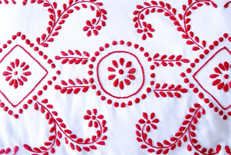 Rött och vitt handarbete stock illustrationer