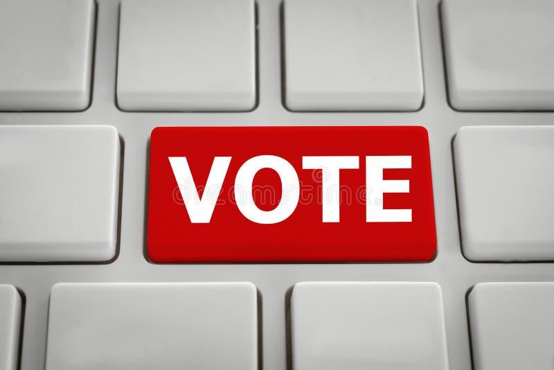 Rött rösta knappen på datoren arkivbild
