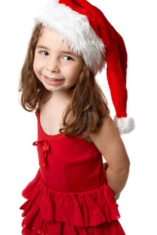 rött santa för flickahatt le royaltyfria bilder