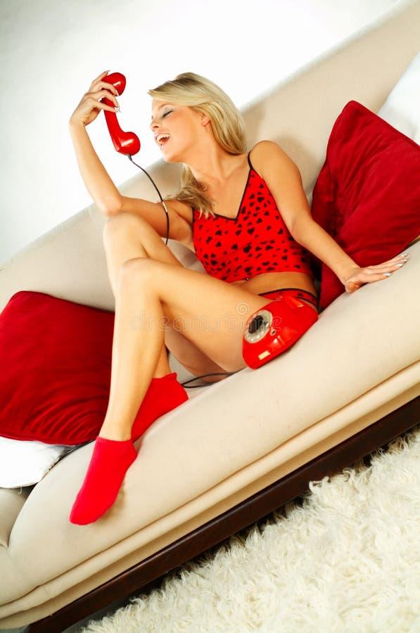 Download Rött Sexigt För Blond Flickaphon Arkivfoto - Bild av gulligt, telefon: 511950
