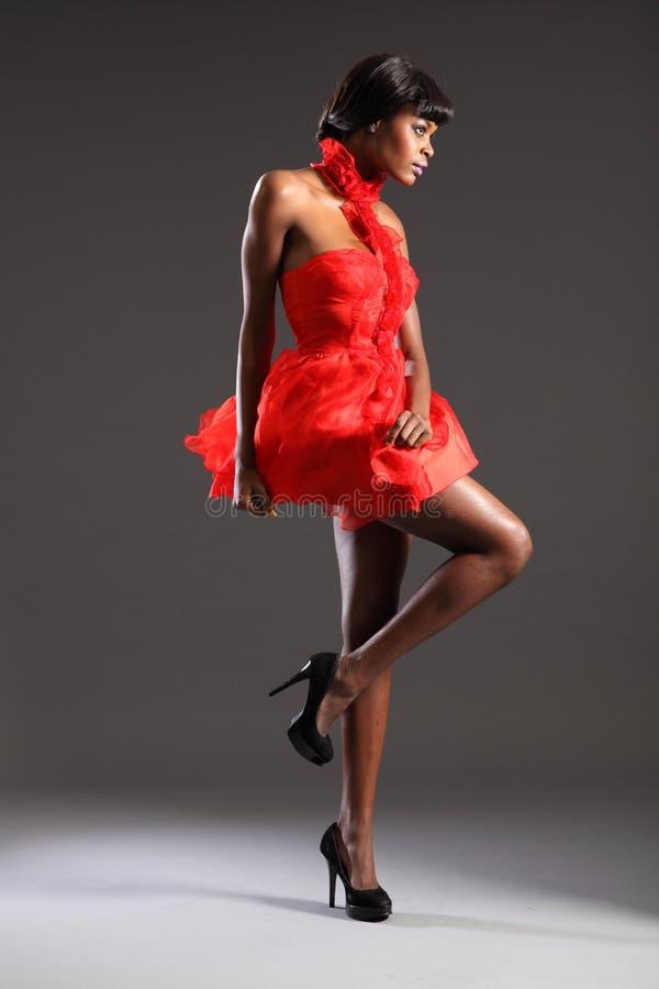 rött sexigt kort slitage för klänningmodemodell arkivbild