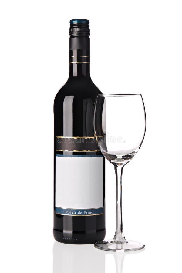 rött vin för flaskexponeringsglas royaltyfri bild