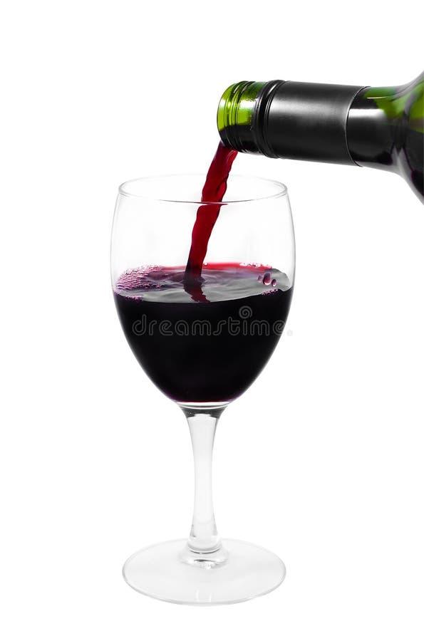 rött vin för klart exponeringsglas för flaska hällande arkivfoton