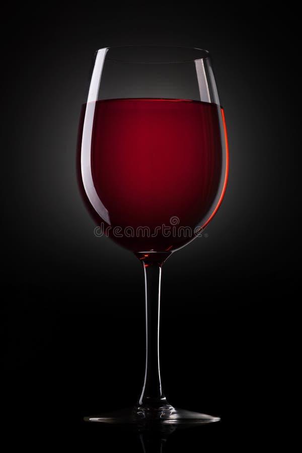 Rött vinexponeringsglas arkivfoton