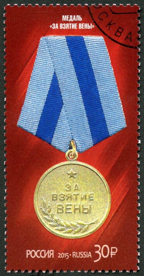 RÚSSIA - 2015: medalha das mostras para a captação de Viena, série o 70th aniversário da vitória na grande guerra patriótica fotos de stock
