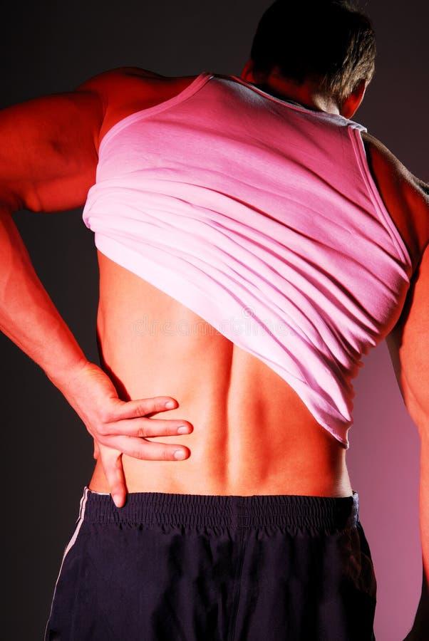 Rückenschmerzen lizenzfreies stockbild