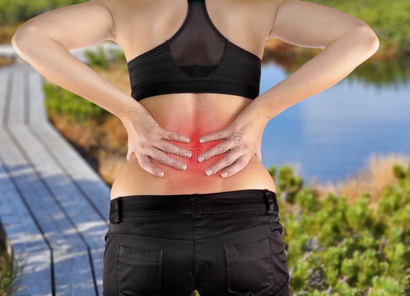 Rückenschmerzenfrau stockbild